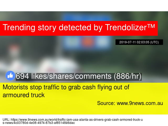 Motorists stop traffic to grab cash flying out of armoured truck